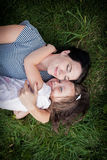 Mother and daughter on the grass top view Stock Photography