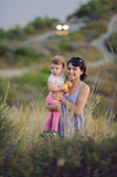 Mother and Daughter in Grass Stock Image
