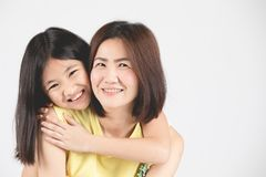 Mother and daughter on gray background stock photos
