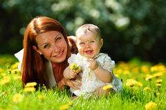 Mother and daughter on the green grass Royalty Free Stock Images