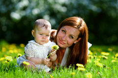 Mother and daughter on the green grass Royalty Free Stock Photo