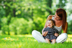 Mother and daughter on the green grass Stock Photography