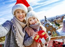 Mother and daughter at Guell Park at Christmas taking selfie Stock Photo
