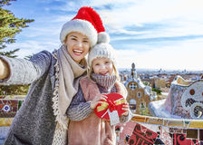 Mother and daughter at Guell Park at Christmas taking selfie Royalty Free Stock Photo
