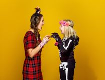 Mother and daughter in halloween costume frightening each other Stock Image