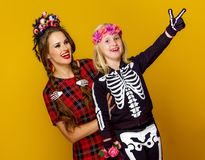 Mother and daughter in halloween costume pointing at something Royalty Free Stock Photography
