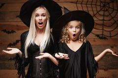 Mother and daughter in Halloween costumes  Stock Photos