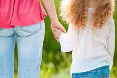 Mother and daughter hand in hand Royalty Free Stock Photo