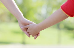 Mother and daughter hand in hand Stock Photography