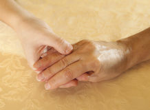 Mother and daughter hands together Stock Image