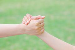 Mother and daughter handshake Stock Photo