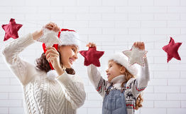 Mother and daughter hang a garland Royalty Free Stock Image