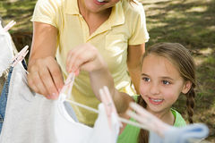 Mother and daughter hanging out washing Royalty Free Stock Image