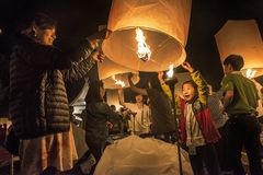 Mother and daughter happily releasing lantern at Yi Peng lantern festival, Thailand stock photography