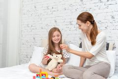 Mother,daughter happy and enjoy playing together. royalty free stock photo
