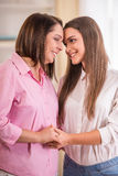 Mother and daughter. A happy family. Mother and teen daughter at home Stock Photos