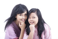 Mother and Daughter Happy Pose. Happy Asian mother and daughter isolated on white Royalty Free Stock Photography