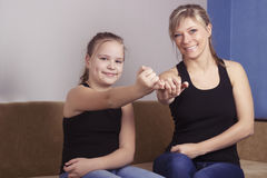 Mother and daughter are happy in reconciliation and promise not to swear at each other.  Royalty Free Stock Photo