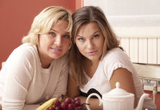 Mother and daughter have breakfast Royalty Free Stock Images