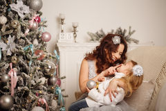 Mother and daughter have a Christmas tree. Royalty Free Stock Images