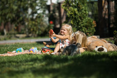 Mother with daughter have fun on the grass. Mother with kids have fun on the grass royalty free stock images