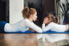 Mother and daughter have fun in the gym Stock Photos