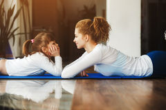 Mother and daughter have fun in the gym Royalty Free Stock Photo