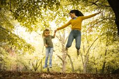 Mother and daughter have fun outside. On the move. Royalty Free Stock Photo
