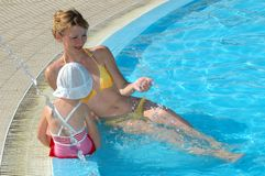 Mother and the daughter have fun at pool Royalty Free Stock Photo
