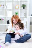 Mother and daughter have fun together Stock Images