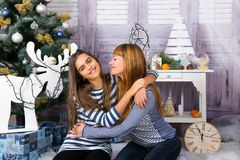 Mom and daughter are happy together at Christmas. Royalty Free Stock Photos
