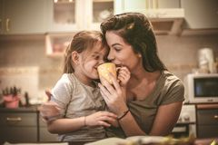 Mother and daughter have fun together. Mommy let me try coffee. Close up image Stock Image