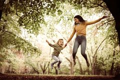 Mother and daughter playing in nature. On the move. Stock Photography