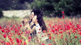Mother and daughter have joy among poppies stock footage