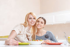 Mother and daughter have lunch Royalty Free Stock Image