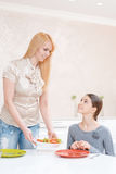 Mother and daughter have lunch Royalty Free Stock Images