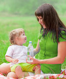 Mother and daughter have picnic drinking water Stock Photo