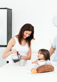 Mother and daughter having breakfast Royalty Free Stock Photography
