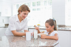 Mother and daughter having breakfast Stock Images