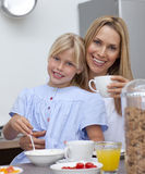 Mother and daughter having breakfast together Royalty Free Stock Photo