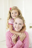Mother And Daughter Having Cuddle Together At Home Stock Photos