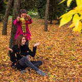 Mother and daughter having fun with autumn leaves Royalty Free Stock Images