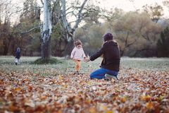Mother and daughter having fun in the autumn park Stock Photography