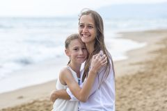 Mother and daughter on the beach royalty free stock images