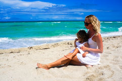 Mother and daughter are having fun at the beach Stock Image