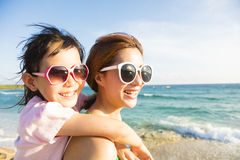 Mother and Daughter having fun on the beach Royalty Free Stock Image