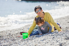 Mother and daughter having fun on the beach Royalty Free Stock Photos