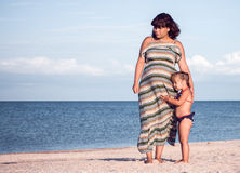Mother and daughter having fun on the beach Royalty Free Stock Photo