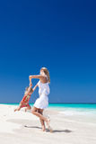 Mother and daughter having fun on  beach Stock Photography