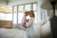 Mother and daughter having fun in the bedroom royalty free stock photos